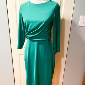 The limited green fitted long sleeve dress draped